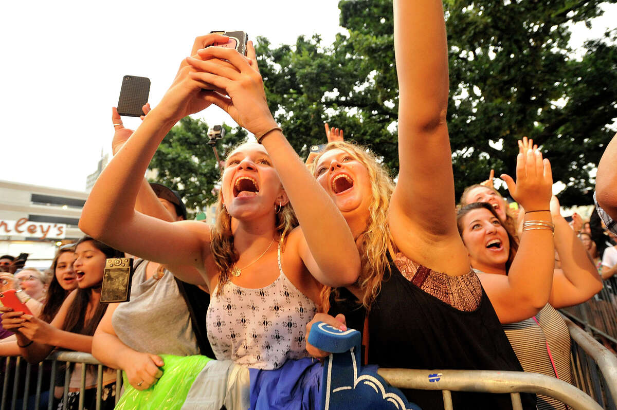 Alison Lomanto, left, and Korynne Sullivan listen as Andy Grammer performs on stage during the Alive@Five concert series at Columbus Park in Stamford, Conn., on Thursday, July 30, 2015. Next week on August 6 The Danbees open for Sister Hazel. Concerts begin at 5 p.m. and run through Thursday, August 13. Hearst Connecticut Media Group is a sponsor of the event.