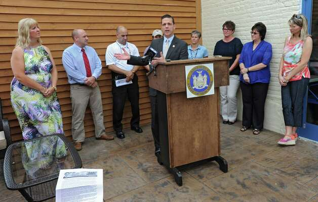 Assemblyman Angelo Santabarbara speaks during a press conference announcing that the county is expanding a program that provides emergency bracelets for autistic children who get lost or run away at Puzzles Bakery & Cafe on Thursday, July 30, 2015 in Schenectady, N.Y. Santabarbara's son was diagnosed with Autism when he was 3. (Lori Van Buren / Times Union) Photo: Lori Van Buren / 10032831A