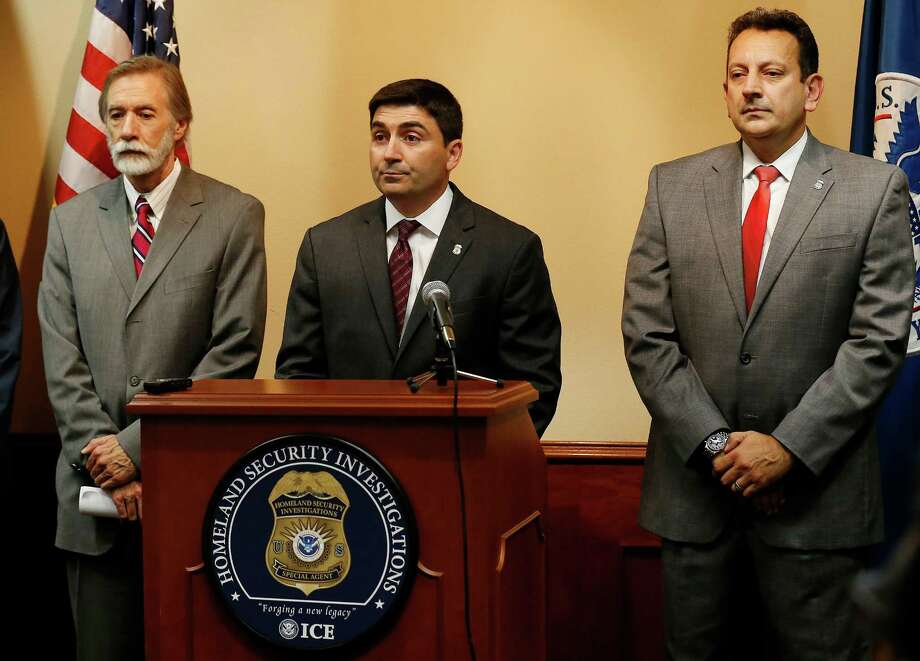 United States Attorney Richard Durbin, Jr. (from left), Homeland Security Special Agent in Charge James Spero and Deputy Special Agent in Charge Aristides Jimenez announce the arrests of 25 individuals indicted for their roles in a human smuggling operation within the state on Thursday, July 30, 2015. Operation Project 83 was a two-year-long investigation that focused on the illegal activity of alien smuggling into the United States. The operation garnered over 400 arrests, seized $187,000, three fire arms and 19 vehicles. Homeland Security credits the collaboration with multiple law enforcements agencies in the results of the arrests and indictments. (Kin Man Hui/San Antonio Express-News) Photo: Kin Man Hui, Staff / San Antonio Express-News / ©2015 San Antonio Express-News