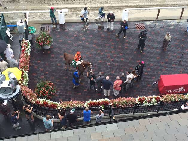 Here is the view of the winner?s circle from the roof of Saratoga Race Course. We?re looking at Stolen Victory, a 3-year-old filly, getting her picture taken after winning the second race over a sloppy track Thursday. That?s Javier Castellano sitting on her back. Gary Contessa is her trainer.