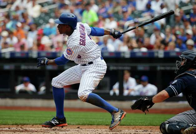 New York Mets' Curtis Granderson hits a fifth-inning, three-run, home run in a baseball game against the San Diego Padres in New York, Thursday, July 30, 2015. (AP Photo/Kathy Willens) ORG XMIT: NYM105 Photo: Kathy Willens / AP