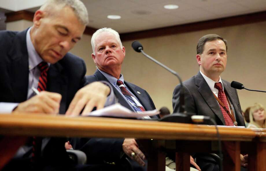 State officials Steve McCraw, from left, Dennis Wilson and Brandon Wood testify before the Texas County Affairs Committee hearing.  Photo: Eric Gay, STF / AP