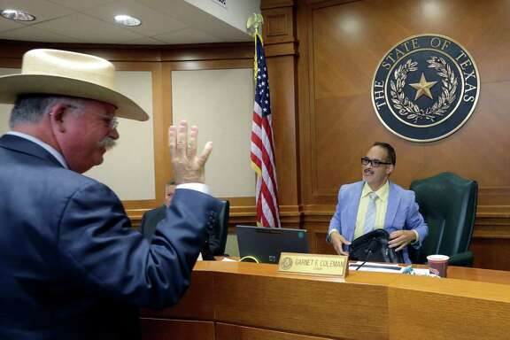 In the wake of Sandra Bland's jailhouse death, Victoria County Sheriff T. Michael O'Connor, left, greets Texas County Affairs Committee chairman Rep. Garnet F. Coleman to discuss jail standards on Thursday in Austin.