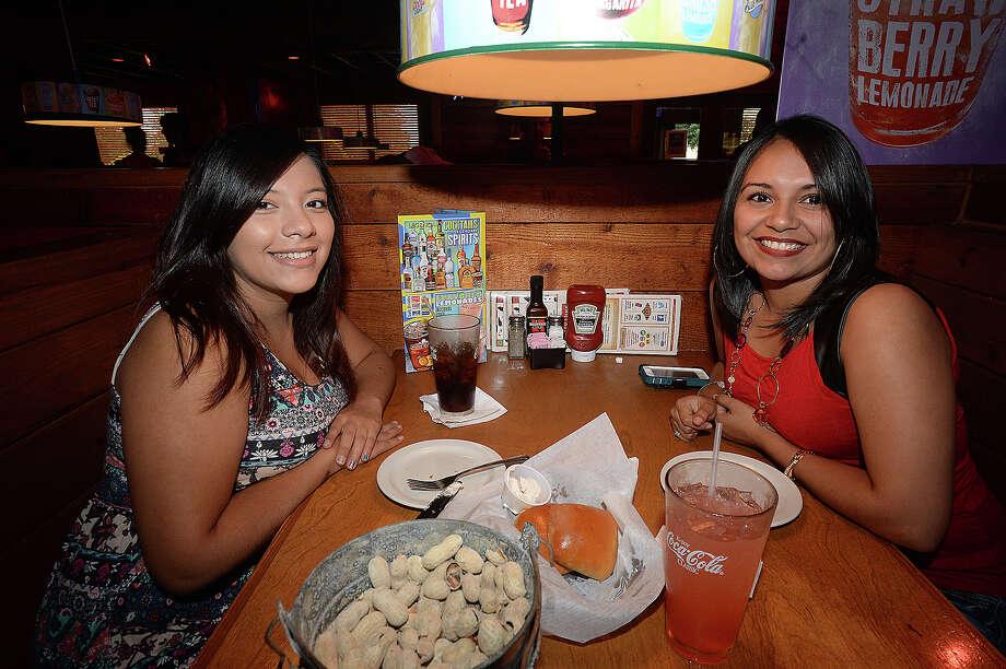 Tania Zavaleta and Diana Sanchez were at Texas Roadhouse during Thursday's Tip-A-Cop fundraiser. Local police officers helped serve the public in a different way at the Port Arthur restaurant, waiting on  diners and collecting donations during the eighth annual Tip-A-Cop event,  whose proceeds benefit Special Olympics Texas. Similar events are taking place at a total of 47 Texas Roadhouse restaurants across the state. Photo taken Thursday, July 30, 2015 Kim Brent/The Enterprise Photo: Kim Brent / Beaumont Enterprise