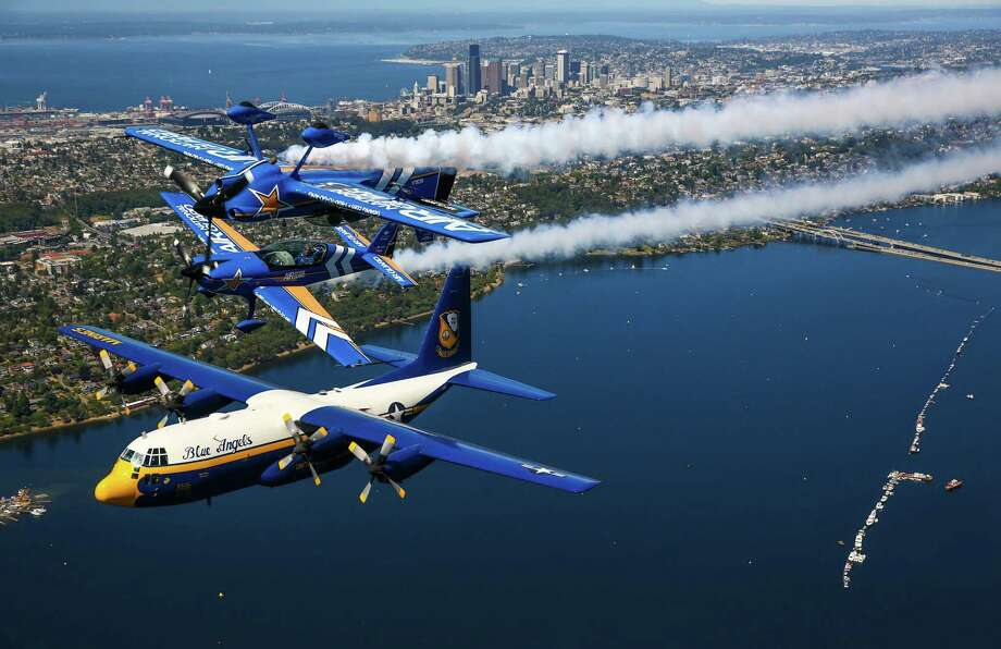"John Klatt Airshows' Air National Guard MX-S and Extra 300L, and the U.S. Navy Blue Angels' C-130, ""Fat Albert,"" fly in formation over Seattle as they prepare for Seafair weekend. Seafair, the traditional summer  Seattle festival, brings hydroplane boats to Lake Washington and aircraft to the skies above for the weekend's Boeing Air Show. Photographed on Thursday, July 30, 2015. Photo: JOSHUA TRUJILLO, SEATTLEPI.COM / SEATTLEPI.COM"