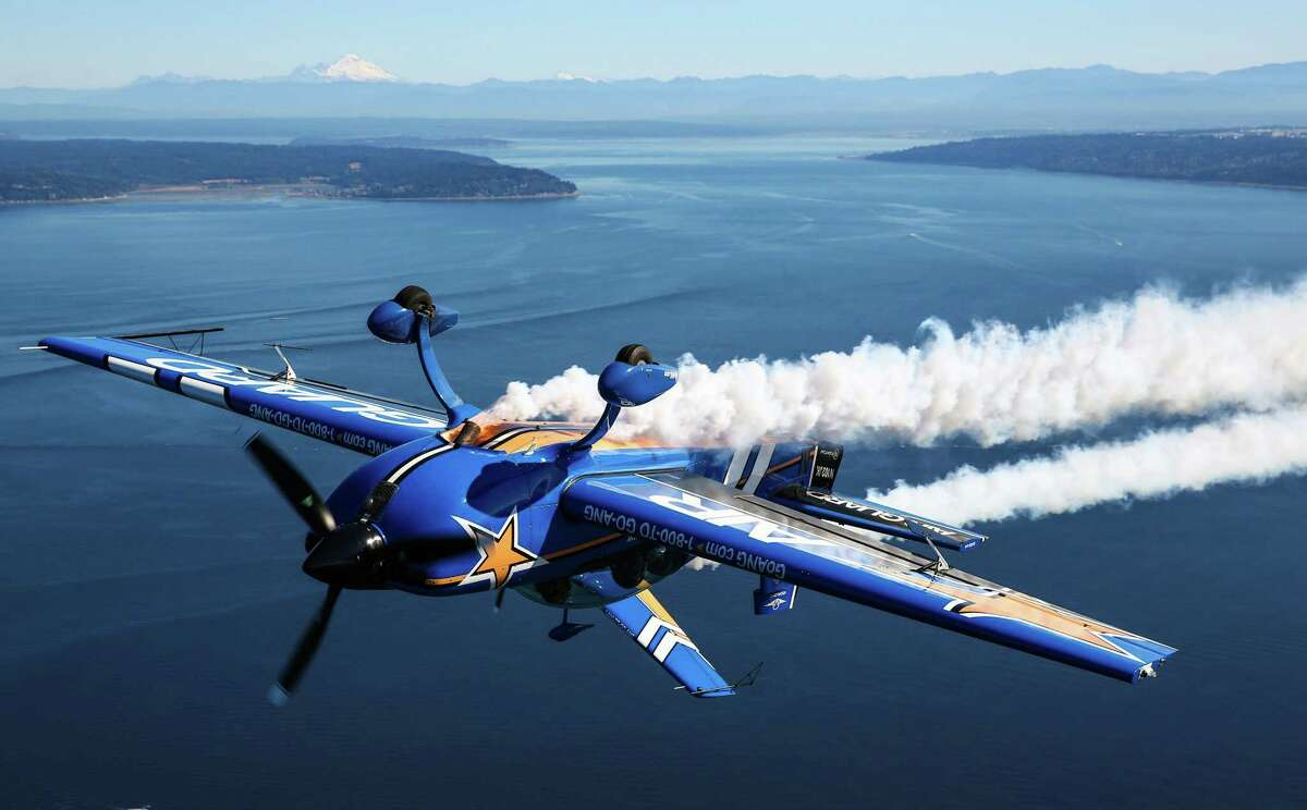 John Klatt Airshows' Air National Guard Extra 300L flies inverted as the team prepares for Seafair.