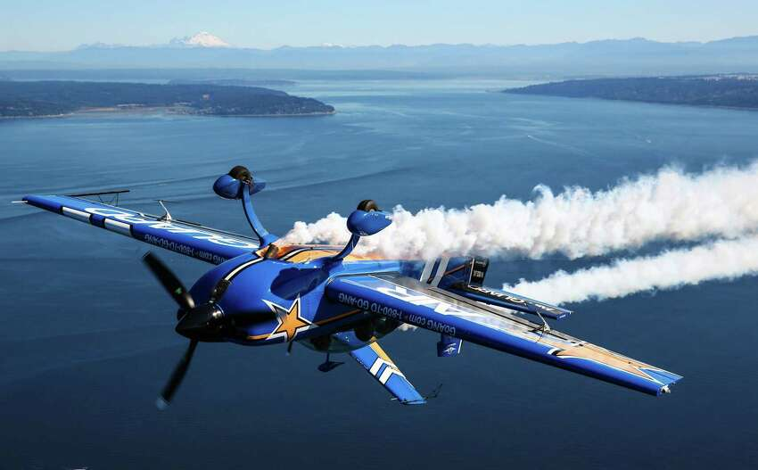 John Klatt Airshows' Air National Guard Extra 300L flies inverted as the team prepares for Seafair.