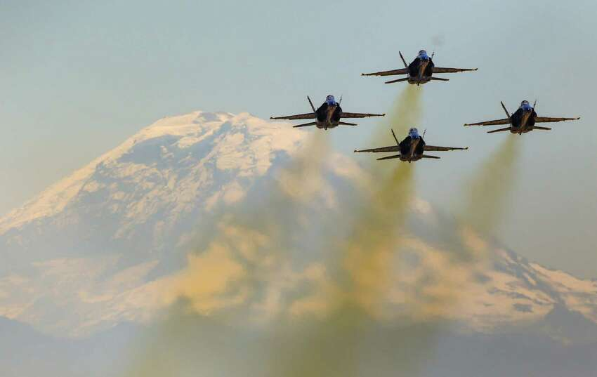 The U.S. Navy's Blue Angels take to the skies over Seattle with Mount Rainier as a backdrop.