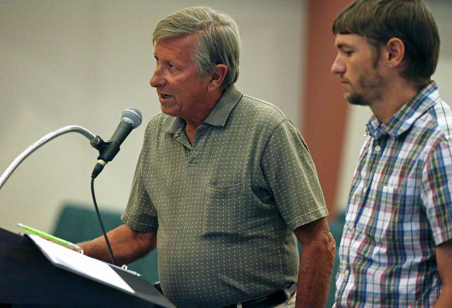 Developer Jim Cook answers questions from city leaders as the Castle Hills City Council hears public statements Thursday concerning the proposal to build 15 houses on a wooded lot within the city. Assisting Cook is Joshua Valenta. Photo: Tom Reel /San Antonio Express-News