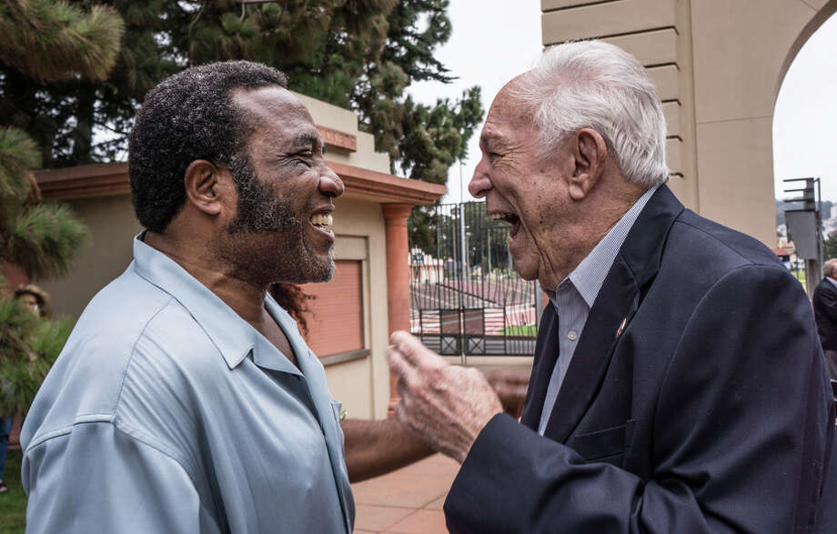 Former 49ers teammates Cedric Hardman and John Brodie speak Thursday at the ceremony at Kezar Stadium. Hartman was a defensive end and a rookie in 1970. / GinoDeGrandis©