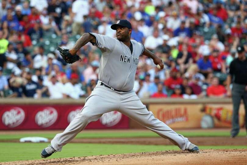 ARLINGTON, TX - JULY 30:  CC Sabathia #52 of the New York Yankees throws against the Texas Rangers i