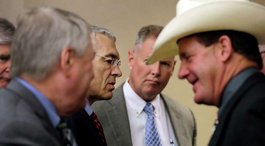 Texas Department of Public Safety Deputy Director Steve McCraw, center with glasses, talks with Victoria County Sheriff T. Michael O'Connor, right, and other officials before the Texas County Affairs Committee hearing to discuss jail standards, Thursday, July 30, 2015, in Austin, Texas. The hearing is the first time lawmakers are meeting to discuss the circumstances surrounding the death of Sandra Bland. Authorities say Bland hanged herself in jail on July 13, a finding that her family has questioned. (AP Photo/Eric Gay) Photo: Eric Gay, STF / Associated Press / AP