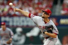 Cincinnati Reds starting pitcher Mike Leake  throws during the first inning of a baseball game against the St. Louis Cardinals Tuesday, July 28, 2015, in St. Louis. (AP Photo/Scott Kane)