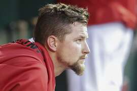 Cincinnati Reds starting pitcher Mike Leake sits in the dugout in the fourth inning of a baseball game against the Minnesota Twins, Monday, June 29, 2015, in Cincinnati. The Reds won 11-7. (AP Photo/John Minchillo)