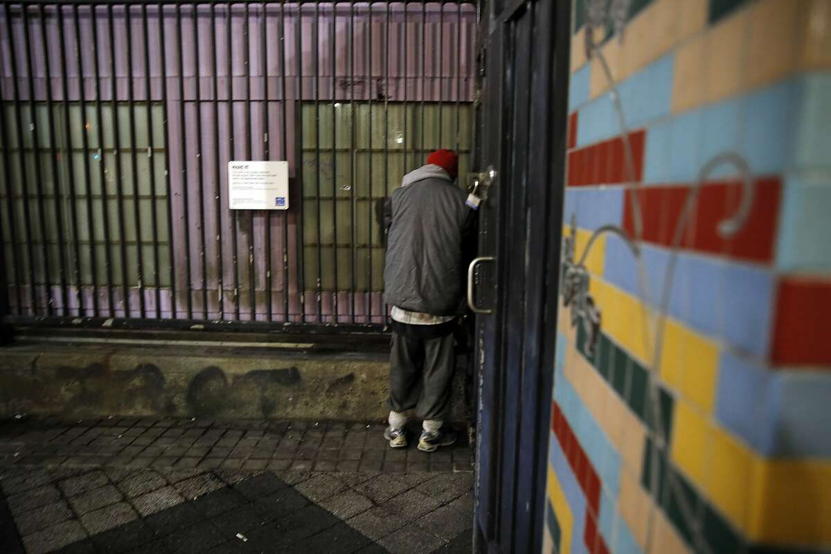 Wayne Howard stands in the corner by a wall that has been coated with pee-repelling paint at the 16th and Mission Street Bart Plaza in San Francisco, Calif., on Thursday, July 30, 2015.