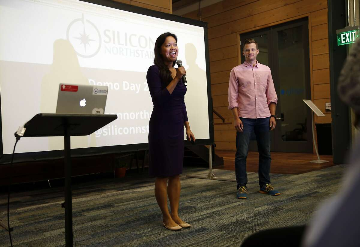 Mary Grove, with her husband Steve, greet the audience at Silicon North Star's Demo Day in San Francisco, Calif., on Thursday, July 30, 2015.