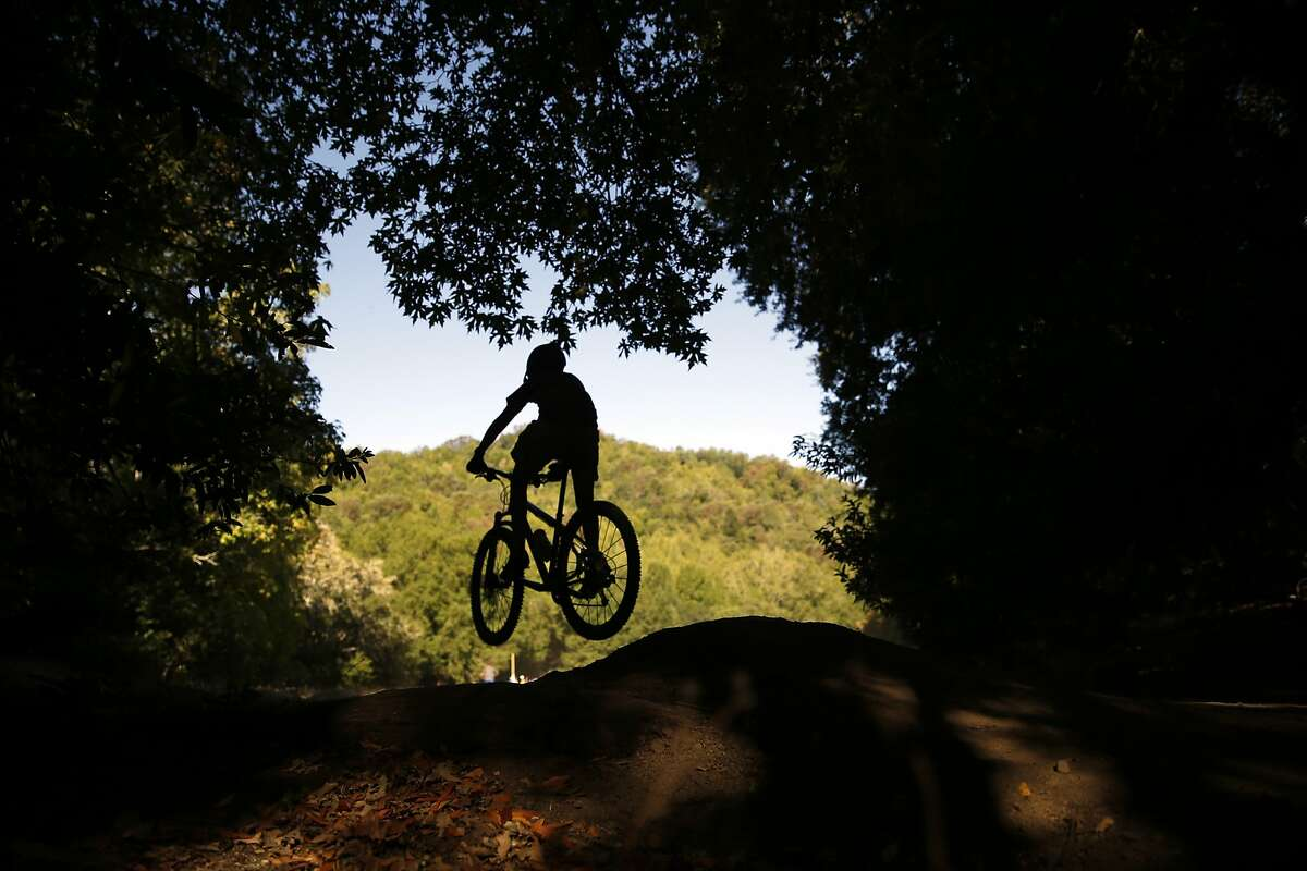 A rider performs a jump at Deer Park during Otis Guy Mountain Bike Camp in Fairfax in July.