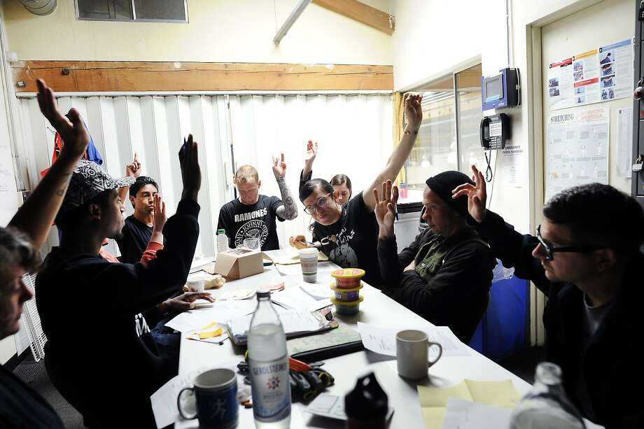 Members of the cooler department raise their hands as they vote on an agenda item during a department meeting at Rainbow Grocery in San Francisco, CA Sunday, July 30, 2015.  Started in 1975, worker owned food co-op Rainbow Grocery is celebrating it's 40th anniversary this year. Photo: Michael Short, Special To The Chronicle