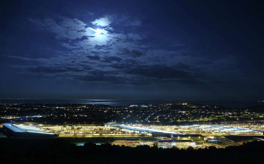 FOLKESTONE, ENGLAND - JULY 31:  The Eurotunnel terminal is illuminated by a rare blue moon on July 31, 2015 in Folkestone, England. Hundreds of migrants are continuing to attempt to enter the Channel Tunnel in Calais, France and onto trains heading to the United Kingdom.  (Photo by Peter Macdiarmid/Getty Images) ***BESTPIX*** Photo: Peter Macdiarmid / 2015 Getty Images