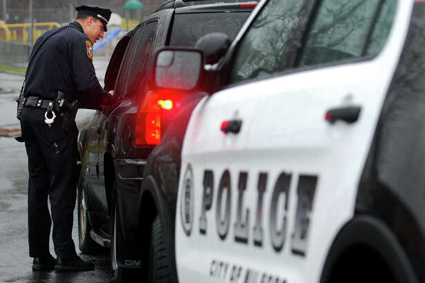 """Milford police officer Kyle Magnan stops a motorist for using his cell phone while driving in downtown Milford, Conn., on Tuesday Apr. 7, 2015. The enforcement effort is called âÄúU Drive. U Text. U Pay,"""" which is targeting distracted drivers who are texting or talking on a cell phone. The state is using a $2.3 million grant from the National Highway Traffic Safety Administration to pay for the enforcement effort, which will run through the month of April."""