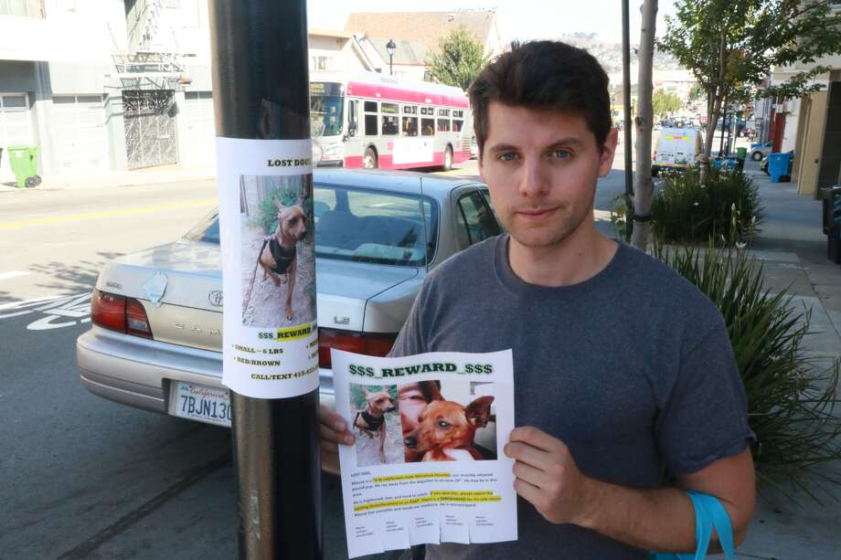 Daniel Altman helps a San Francisco local who lost a dog put up fliers on San Bruno Avenue in Visitacion Valley.
