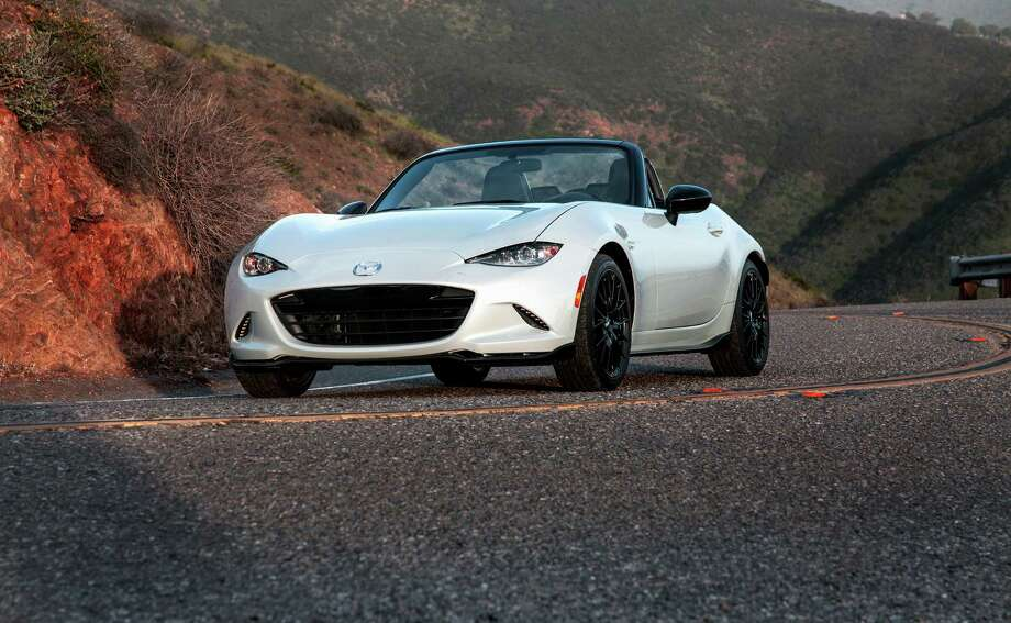 The new Miata's larger windshield and lower hood improves visibility and at speed heightens the driver's sense of being connected to the road. Sharp-looking new headlights are LEDs that are brighter than the older car's HID xenons. Photo: Mike Ditz, El Hefe / 2015