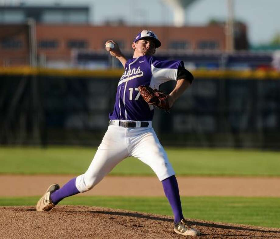 Port Neches-Groves' Carter Henry, No. 17, throws against a Nederland hitter during Tuesday's game. The Port Neches-Groves Indians hosted the Nederland Bulldogs in a first place showdown for District 22-5A Photo: Photo Taken By: Jake Daniels