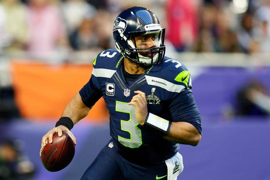 Quarterback: Russell WilsonYears with Seahawks: 2012-present Seahawks stats: 794-of-1,252 passing (63.4 percent), 9,950 yards, 72 touchdowns, 26 interceptions; 308 rushing attempts, 1,877 yards, 11 touchdowns Career stats: Same.Notes: It was a good day for Russell Wilson. Not only did he sign a four-year contract extension with Seattle that makes him one of the highest-paid players in the league, but he also ran away with our quarterback position, racking up over 57 percent of the over 3,200 votes cast. Photo: Kevin C. Cox, Getty Images
