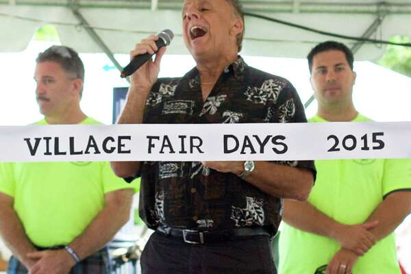 "Ray Plue of the band Higher and Higher belts out an inspired ""Star Spangled Banner""to help open Village Fair Days."