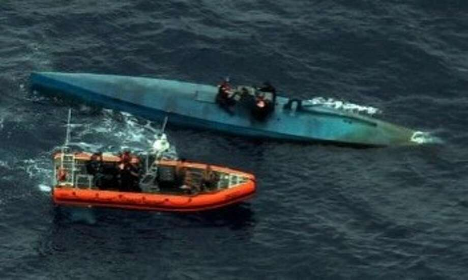 A small semi-submersible vessel containing four people and eight tons of cocaine was discovered by the U.S. Navy and the U.S. Customs and Border Protection officials on July 18 in the eastern Pacific Ocean. Photo: U.S. Customs And Border Protection Office