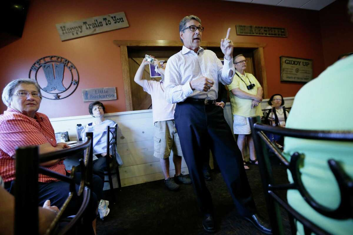 It appears that Republican presidential candidate Rick Perry will not be in the prime-time GOP debate Thursday. He has struggled in the polls. Here he speaks during a meet and greet with local residents in Fort Dodge, Iowa on July 13.