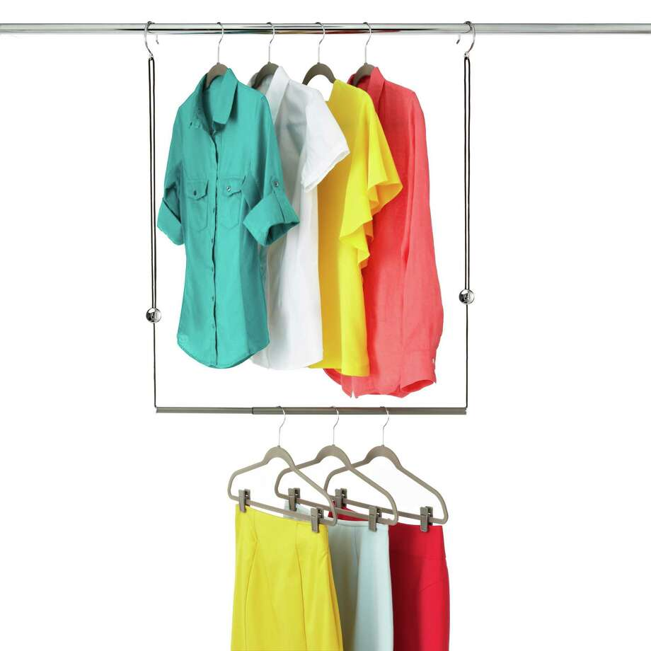 The tight closet space in dorm rooms can be expanded with hanging rods that provide another layer of hanging space. Photo: Courtesy Container Store