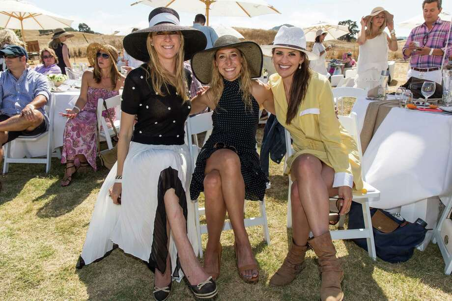 Lauren Wolfe, Jess Perez and Meredith Kendall at the 12th Annual Stick & Ball Oyster Cup Polo Tournament on July 25, 2015. Photo: Drew Altizer Photography / © 2015 Drew Altizer Photography