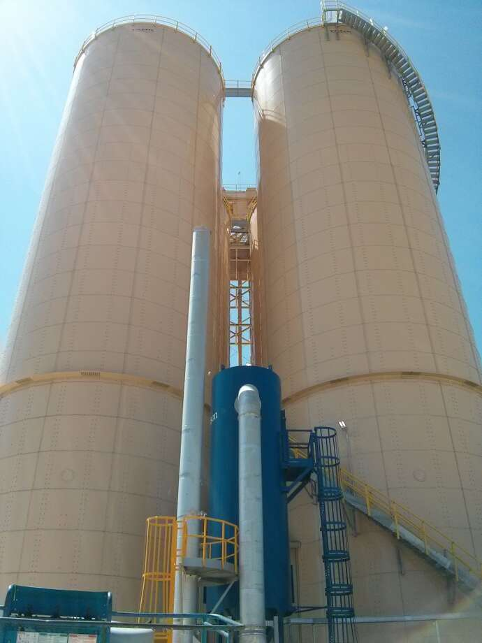 Two the sand silos at the Southton Rail Yard, which opened in 2014 in southern Bexar County near the intersection of Interstate 37 and Loop 410. The sand comes in by rail and is stored in the silos, each of which holds around 5,000 tons of sand, before being moved south by truck. (Jennifer Hiller/San Antonio Express-News) Photo: San Antonio Express-News