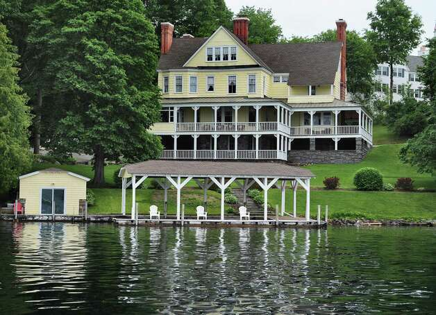 Mike Chrys' 19C house on the shores of Lake George next to the Sagamore Hotel, upper right, Friday June 12, 2015 in Bolton Landing, NY.   (John Carl D'Annibale / Times Union) Photo: John Carl D'Annibale / 00032208A