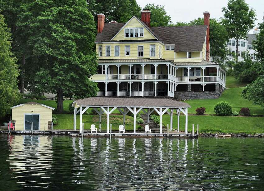 Mike Chrys' 19C house on the shores of Lake George next to the Sagamore Hotel, upper right, Friday June 12, 2015 in Bolton Landing, NY. (John Carl D'Annibale / Times Union)