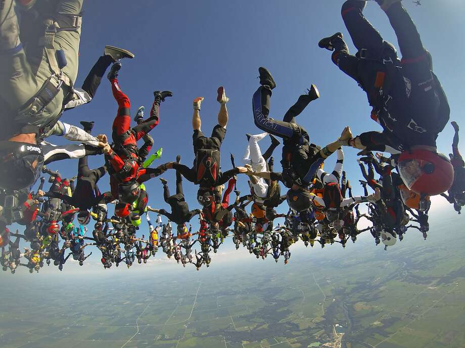 It took the international team 13 attempts to build the skydiving formation that beat the 2012 mark set by 138 skydivers. Photo: Mickey Nuttall, Associated Press