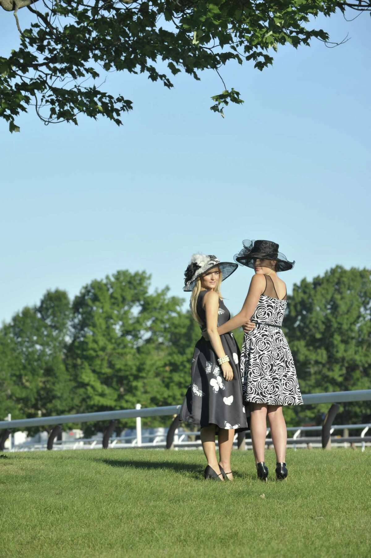 Chloe Aviza, left, is wearing a hat made by Susanne Dura, owner of Fancy Schmancy in Latham and a Fancy Schmancy private label dress. Clothing provided by Fancy Schmancy. Lyndsey Lowe, right, is wearing a hat by Scala and a dress by Frank Lyman. Clothing provided by Lifestyles in Saratoga Springs. (Photo Paul Buckowski / Times Union)