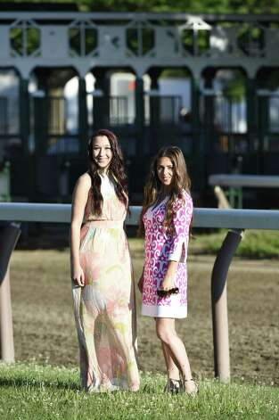 Jessica Hoesel, left, wears an X Taren dress. Clothing provided by Saratoga Sundress. Lauren Lis, right, is wearing a Jude Connally dress. Clothing provided by Saratoga Saddlery in Saratoga Springs. (Photo by Paul Buckowski / Times Union)