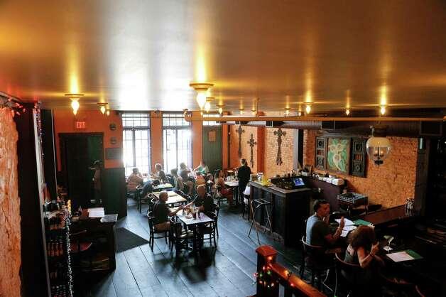 Patrons enjoy lunch inside the Mexican Radio restaurant on Warren St. on Thursday, June 25, 2015, in Hudson, N.Y.  (Paul Buckowski / Times Union) Photo: PAUL BUCKOWSKI / 00032353A
