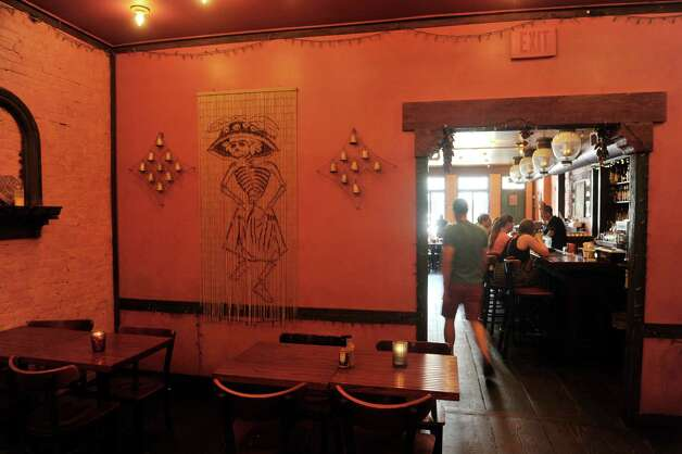 A view of one of the rooms inside the Mexican Radio restaurant on Warren St. on Thursday, June 25, 2015, in Hudson, N.Y.  (Paul Buckowski / Times Union) Photo: PAUL BUCKOWSKI / 00032353A