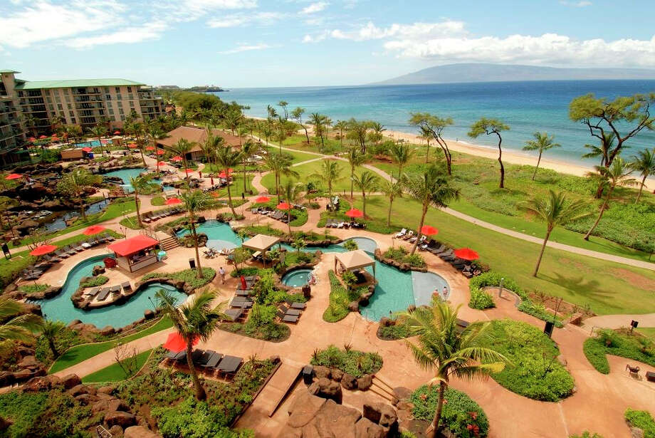"""A cheap sleep in Maui This view of the 38-acre Honua Kai Resort & Spa on Maui's Ka'anapali Beach is idyllic, but if you're willing to book one of its units overlooking a neighboring construction site (not pictured), you can knock as much as 40 percent off of a one-or two-bedroom suite, starting at $230 per night. Call (888) 529-8527 to ask for the """"Hard Hat"""" rate, valid for stays through Jan. 5, 2016; book by Sept. 1. Those traveling with children should ask for the Keiki Hard Hat rate—same discount, but comes with a construction-themed toy. Photo: Honua Kai Resort & Spa"""