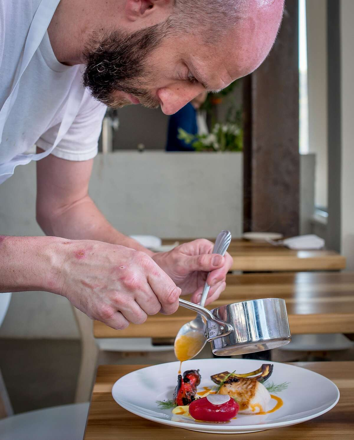 Chef Rupert Blease plates the fried Cod at Lord Stanley in San Francisco, Calif., on July 30th, 2015.