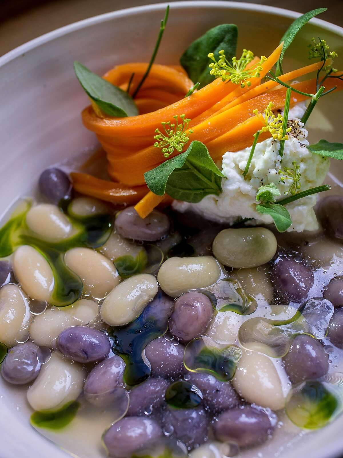 Shelling Beans with fresh Ricotta, Carrots and Dill at Lord Stanley in San Francisco, Calif., are seen on July 30th, 2015.