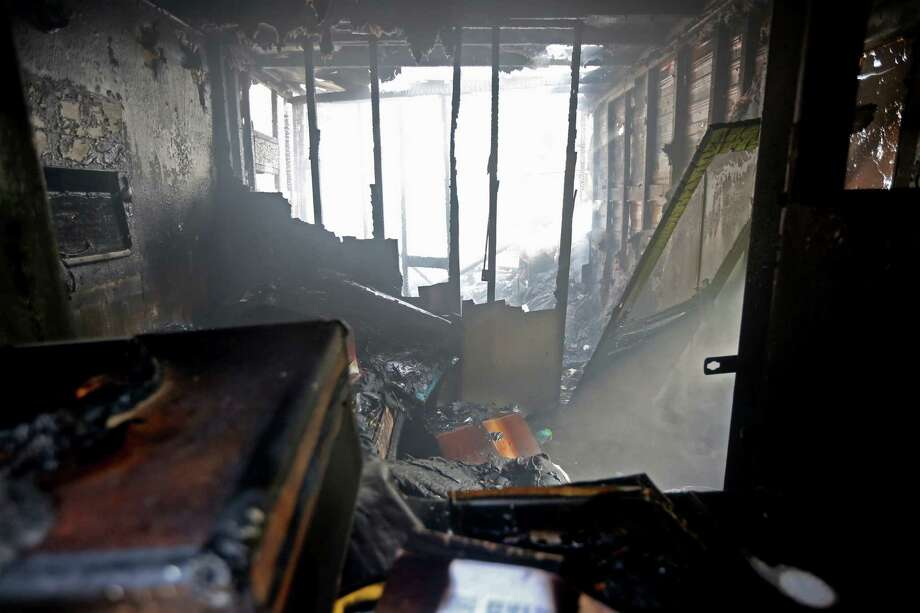 The inside of a smoldering trailer home that caught fire around 9 a.m. along the 600 block of W. 19th St. Friday, July 31, 2015, in Houston. Houston Fire Department responded to the one-alarm fire. While along his route, Metro Bus driver Paul Nelson saw the fire, got out of the bus to remove a man from the trailer who suffered second and third degree burns. Photo: Gary Coronado, Houston Chronicle / © 2015 Houston Chronicle