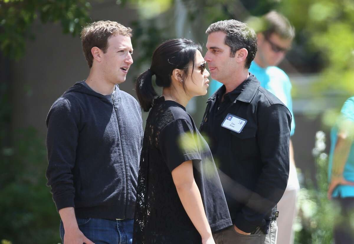 Mark Zuckerberg (left), chief executive officer and founder of Facebook Inc.and his wife Priscilla Chan chat with Dan Rose, VP of Business Development and Monetization at Facebook, at the Allen & Company Sun Valley Conference on July 9, 2015 in Sun Valley, Idaho.