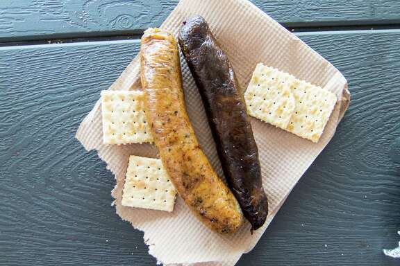 Triple J's Smokehouse offers spicy, right, or mild, left, Louisiana-style boudin.