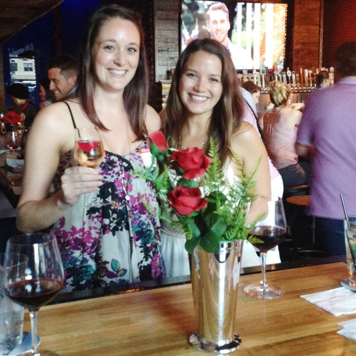 Holly Oller and Breanna Bueche at The Bachelorette's season finale screening party hosted by local contestant Cory Shivar at Barley & Bovine