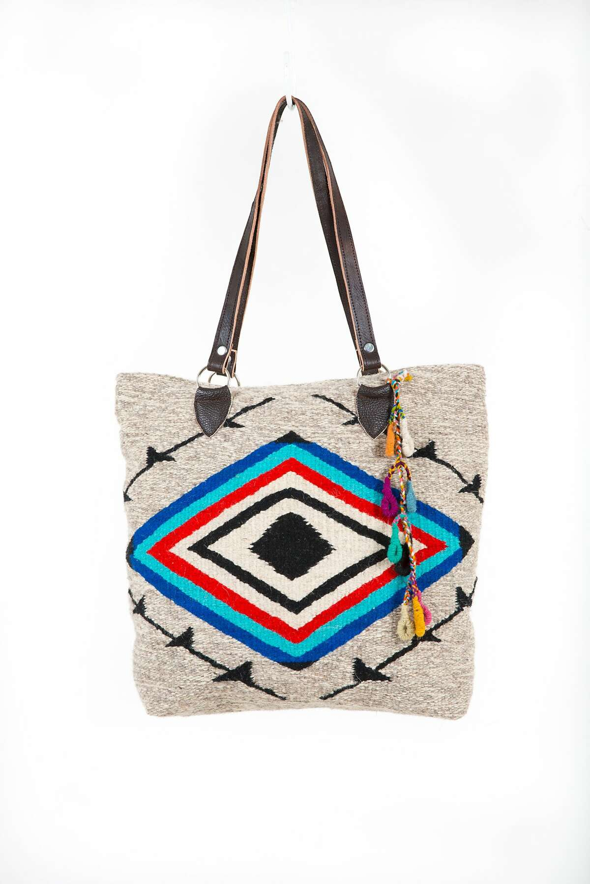 Rugs by Roseli Ilano, an Oakland-based textile designer. Oversized weekender, $300. Double sided seeing eye tote, $250. Available at www.ilanodesign.com.