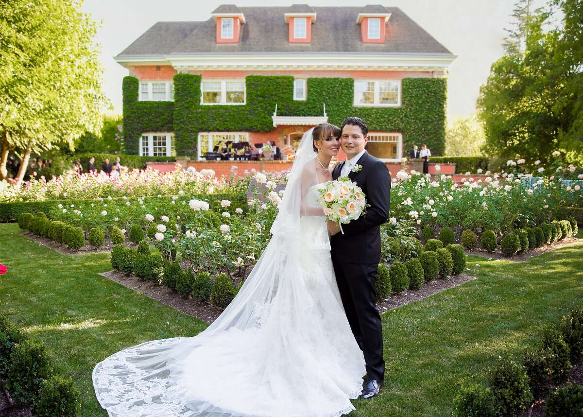 Wine entrepreneurs Serge Troxel and Olya Sadovskaya wed July 15, 2015, in St. Helena, CA, in a ceremony at the home of his mother and stepfather, with a small ensemble of the Russian National Orchestra performing during the reception. The bride's gown was made by Vera Wang. The groom wore a Hugo Boss tuxedo.
